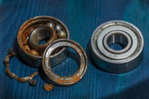 Comparison of corroded bearing and new bearing